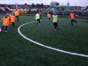 Childrens football on the Muga